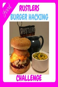 Image showing a delicious burger hacked with redcurrant jelly, stuffing, sweet potato mash, yorkshire pudding all held together with a metal skewer