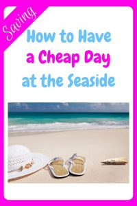 How to have a cheap day at the seaside - an image of a white sandy beach with a beautiful blue sea