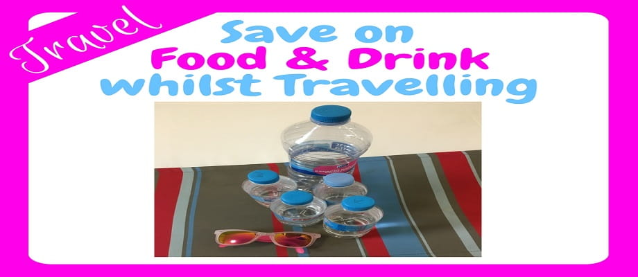 How to save on food and drink whilst travelling - and image of bottles of water and a pair of sunglasses laid out on a hotel bed
